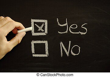 vote yes or no written on chalkboard or blackboard...