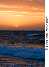 sunrise - the first rays of the sun over ocean