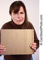 Woman with brown hair holding up one piece of cardboard.
