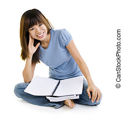 Asian student sitting on floor, blank book ready for text.