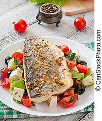 Baked seabass with Greek salad.