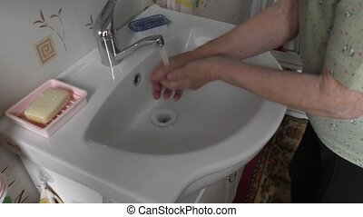 Woman technique hands in the sink - Elderly Woman technique...