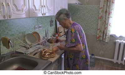 woman is considering products - An elderly woman is...