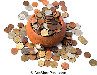 Pile of coins Baht currency is poured out the Pottery cup on...