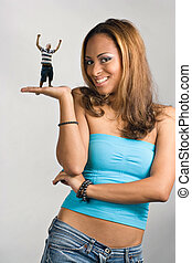 Girl Holding a Mini Man