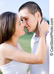 kiss - a teen couple kissing in garden