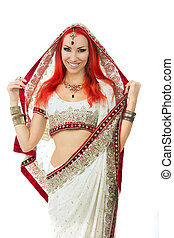Beautiful Redhead Sexy Woman in Traditional Indian Sari Clothing with Bridal Makeup and oriental jewelry