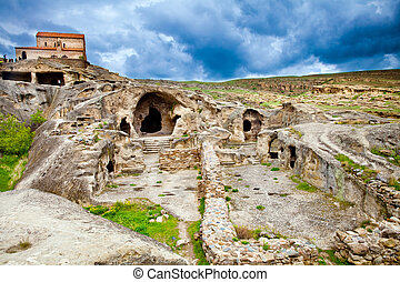 Uplistsikhe rock city in Georgia - Uplistsikhe is an ancient...