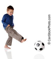 Kicker - A barefoot preschooler kicking a soccer ball...