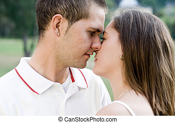 young lovers kissing in garden