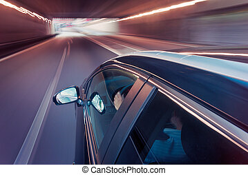 Car driving through a tunnel