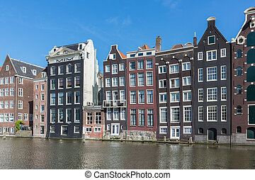 Amsterdam city with historic houses along Canals