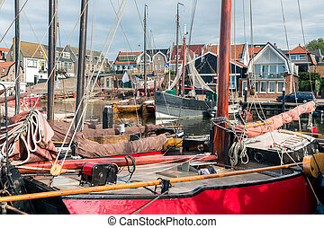 Historic wooden ships in harbor of Urk, old Dutch fishing village