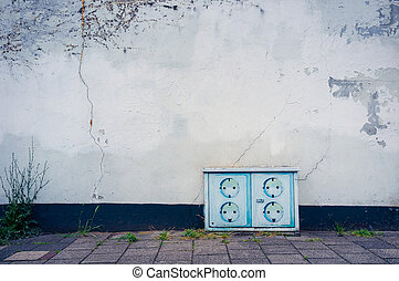 Power outlet on a wall - Artful solution to use a painted...