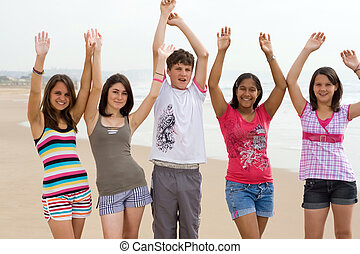 fun teenagers - five teenagers having fun on the beach...