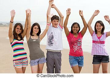 fun teenagers - five teenagers having fun on the beach...