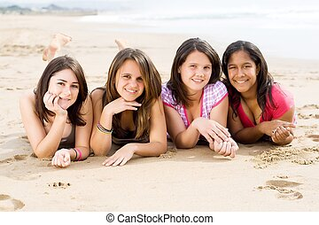 pretty teen girls - a group of pretty teen girls posing on...