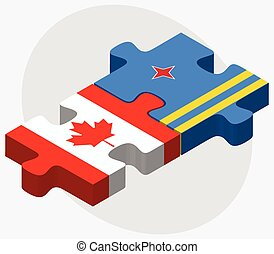 Canada and Aruba Flags in puzzle isolated on white...