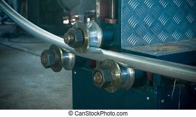 Aluminium tube bending process closeup