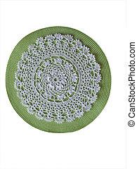 Crochet doily background - white crocheted doily on green...