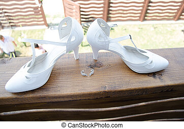 Bride shoes on wooden railing
