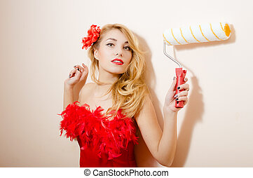 Blonde with roller brush - Serious young woman holding...