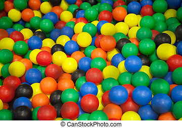 Colorful plastic balls on children's playground