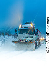 Winter safety - Trucks clearing the snow with their snow...