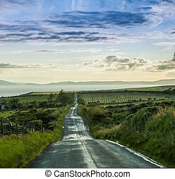 endless road by rainy landscape highlands scaotland
