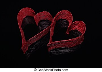 Red hearts on a black background