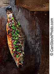 Whole Roasted Fish Garnished with Green Onions - High Angle...