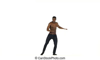 Afro american man dancer with naked torso dancing latina...