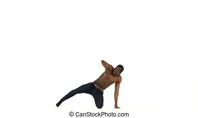 Afro american man dancer with naked torso starting dancing...