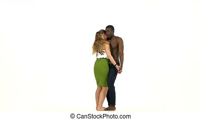 Young girl and afro american man with naked torso finish...