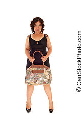 Mixed raced woman holding her purse - A young mixed raced...