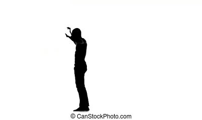 Afro american man with naked torso enjoy dancing social latina dance on white, silhouette