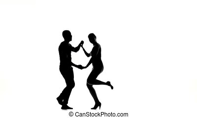 Girl and afro american man with naked torso barefoot dancing...