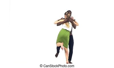Young social latina dancer continue dancing, on white, slow...