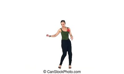 Attractive social latina dancer with ponytail continue dancing, on white, silhouette, slow motion