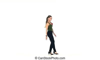 Young social latin dancer continue moves, on white, slow...