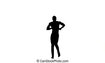 Happy afro american man dancer dancing barefoot latina dance on white, silhouette, slow motion