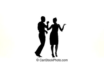 Two latino dancers finishing dancing, silhouette, on white, slow motion