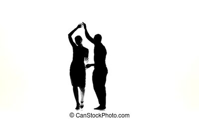 Latino dancers in action on white, silhouette, slow motion