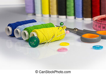 sewing supplies - set of sewing thread on a white background