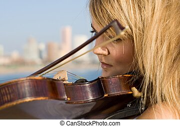 violin player - girl playing violin on beach