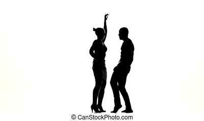 Attractive couple of social latino dancers continue dancing...