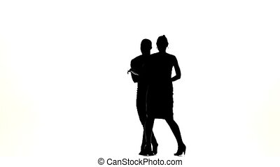 Talanted couple of social latin dancers continue dancing on...