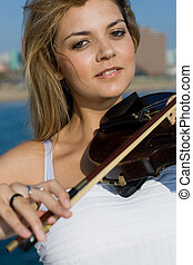violinist - a smiling violinist on beach