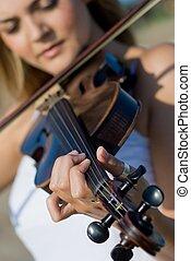 violin - a close-up of woman playing violin