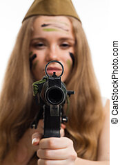 Woman look at camera through gun sight with camouflage on...